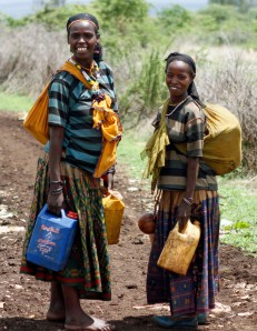Adolescent girls in Ethiopia fetch water