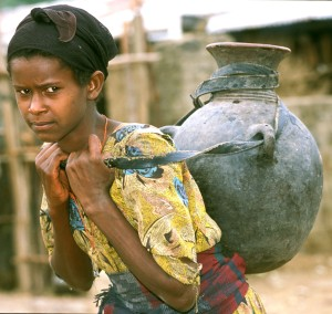 Girl in Ethiopia carrying water. Copyright: WHO/P. Virot.